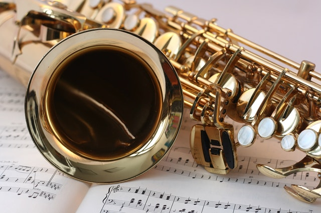 wind instrument on music sheets for UH Bands Concert Composition Competition